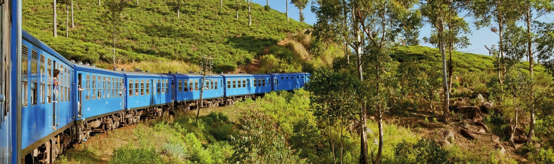 Travel by train through scenic mountain landscape